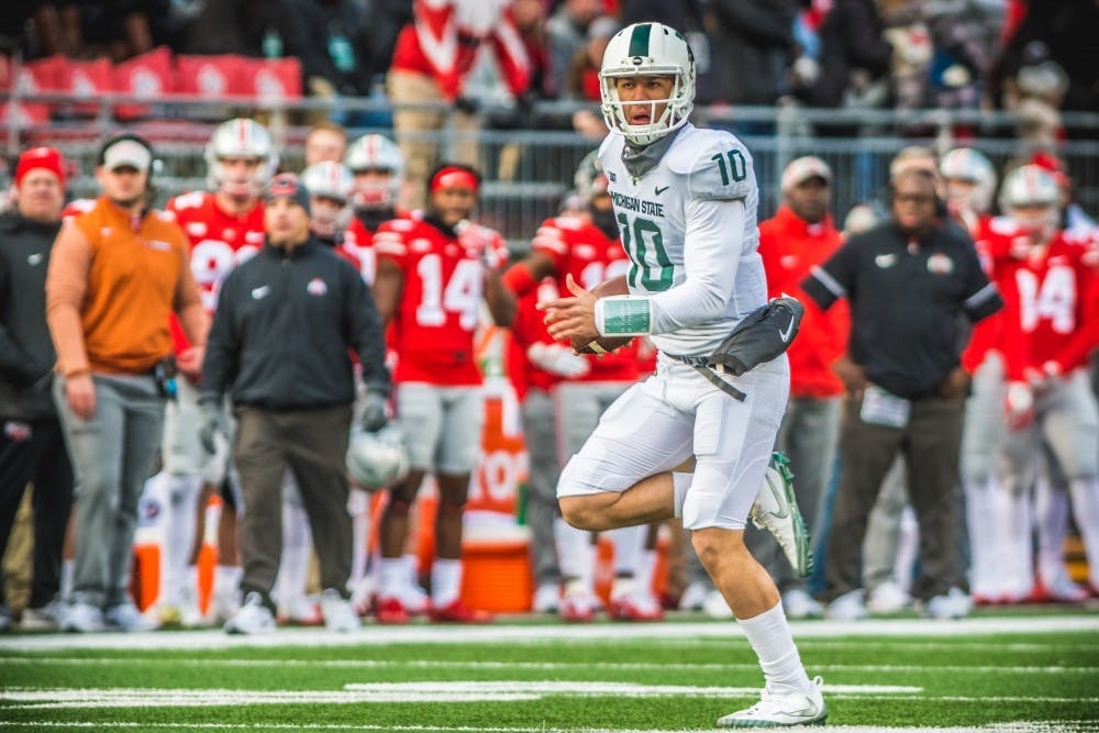 Redshirt freshman quarterback Messiah deWeaver (10) runs the ball during the game against Ohio State, on Nov. 11, 2017, at Ohio Stadium. The Spartans were defeated by the Buckeys, 48-3.