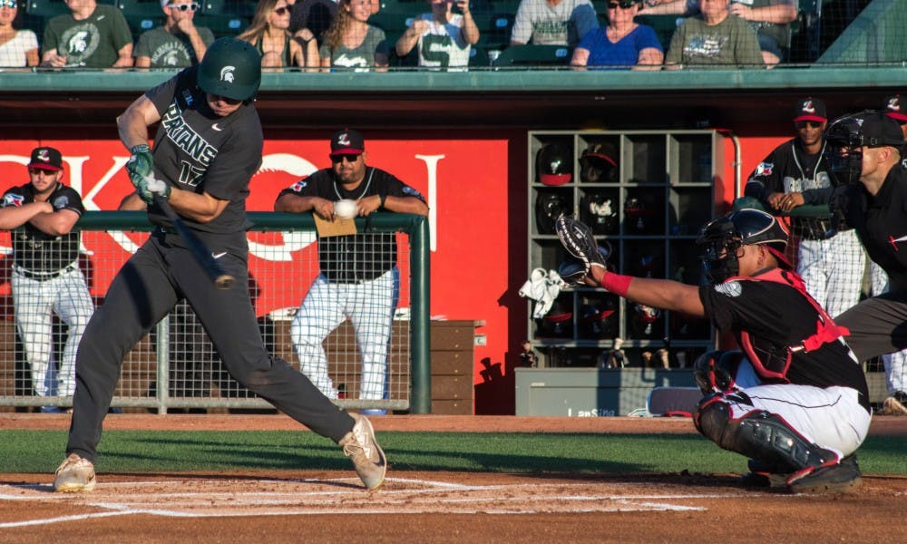 Junior outfielder Bryce Kelley (17) swings at a pitch during the game at Cooley Law School Stadium on Sep. 4, 2018. The Lugnuts defeated the Spartans 6-4.