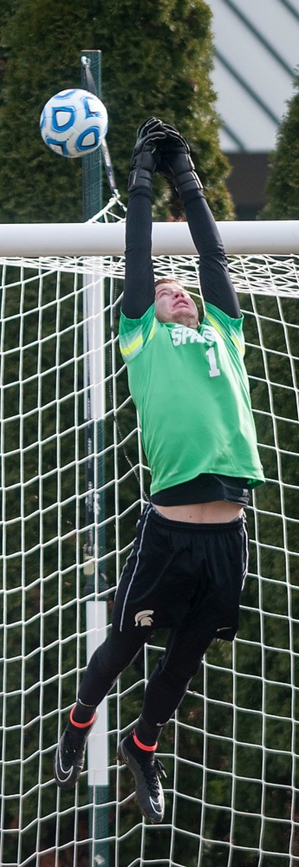 <p>Junior goalkeeper Zach Bennett  attempts to block the shot during the game against Providence College on Dec. 6, 2014, at DeMartin Stadium at Old College Field. The Spartans were defeated by the Friars, 2-3. Raymond Williams/The State News</p>