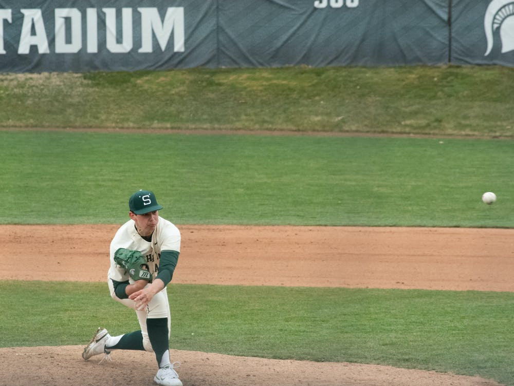 Michigan State's Nick Powers (46) pitches the ball in the Spartans' victory on March 28, 2021.