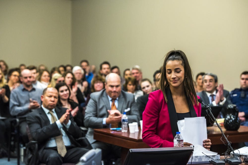 The courtroom claps after six-time Olympic medal winner Aly Raisman addressed Ex-MSU and USA Gymnastics Dr. Larry Nassar in her statement on the fourth day of Nassar's sentencing on Jan. 19, 2018 at the Ingham County Circuit Court in Lansing. (Nic Antaya   The State News)