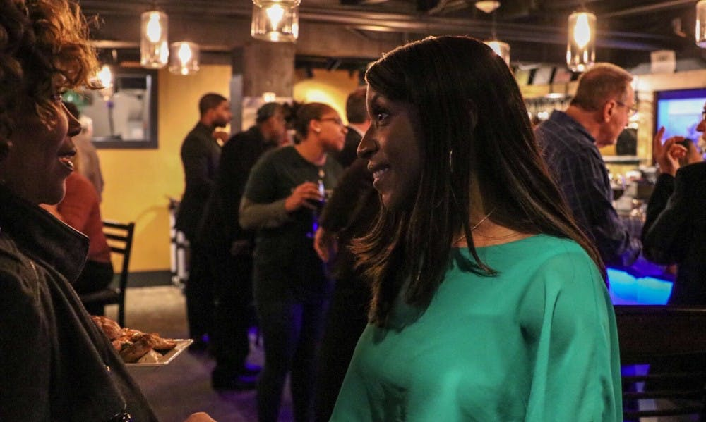 <p>Brianna Scott talks to members of the audience at her watch party Nov. 6, 2018.&nbsp;</p>