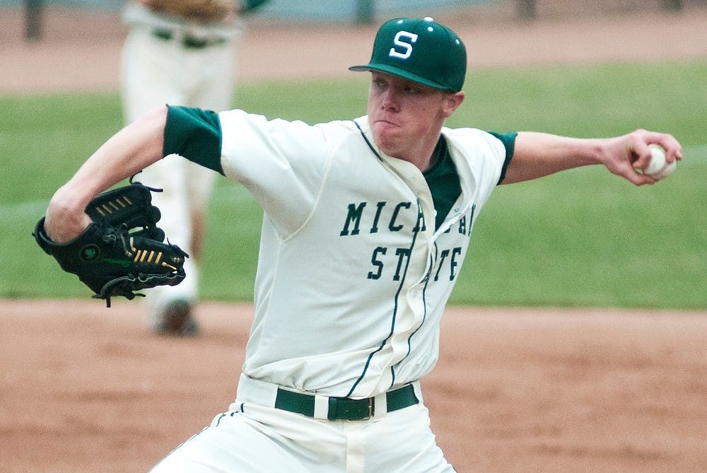 <p>Freshman pitcher Cam Vieaux winds up for a pitch during the game against Purdue on April 12, 2014, at McLane Baseball Stadium at Old College Field. The Spartans defeated the Boilermakers, 2-1. Danyelle Morrow/The State News</p>