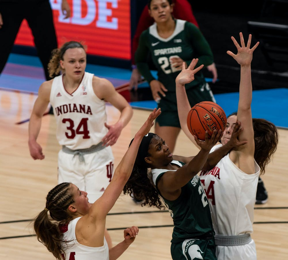 <p>Clouden fights off Indiana defenders to score during the second quarter. The Spartans will advance to the semifinals of the Big Ten Tournament after defeating the Hoosiers 69-61 at Bankers Life Fieldhouse. Shot on March 11, 2021.</p>