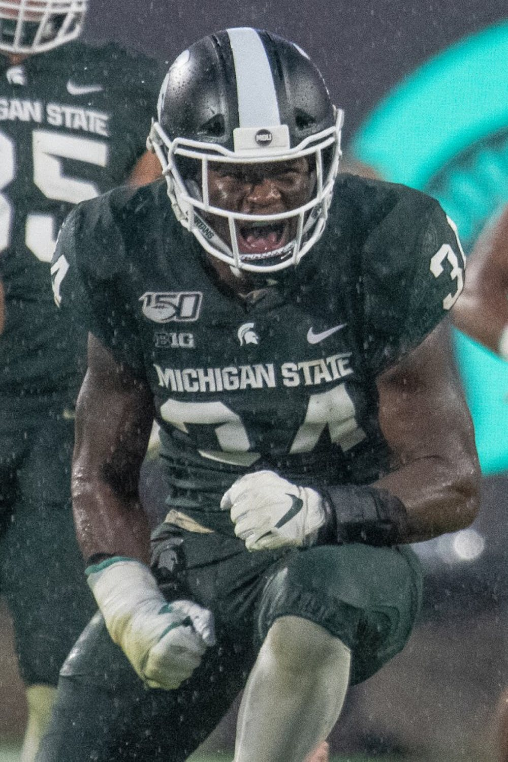 <p>Junior linebacker Antjuan Simmons (34) celebrates during the game against Penn State on Oct. 26, 2019 at Spartan Stadium. The Spartans fell to the Nittany Lions, 28-7.</p>