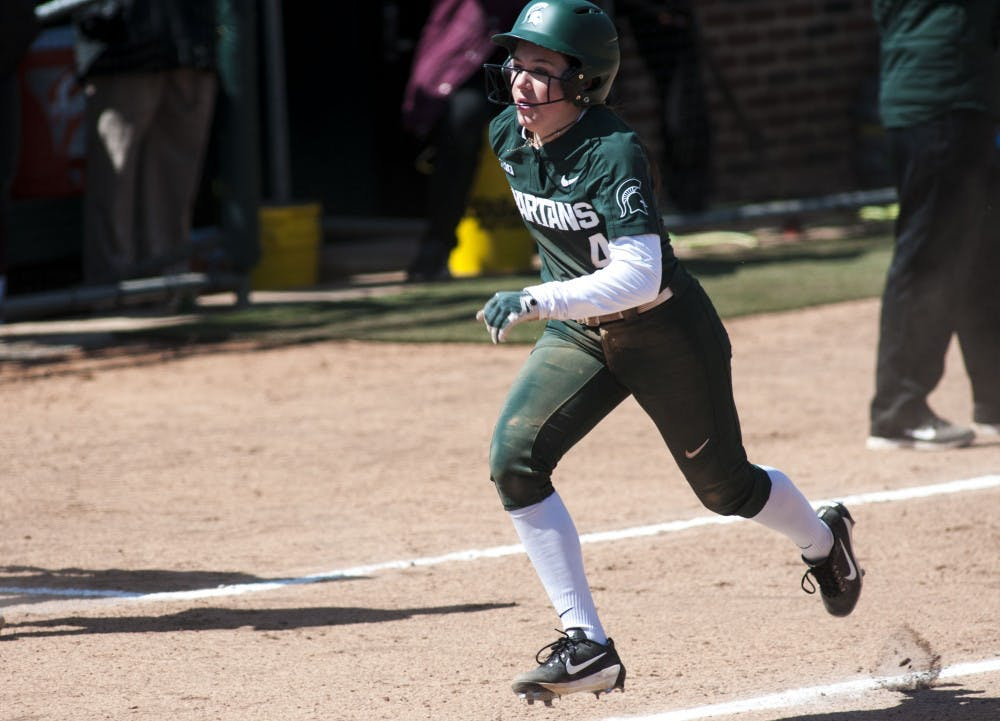 <p>Freshman outfielder Katie Quinlan (4) runs during the game against Minnesota April 8, 2018 at Secchia Stadium. The Vikings defeated the Spartans, 6-2. (Annie Barker | State News)</p>