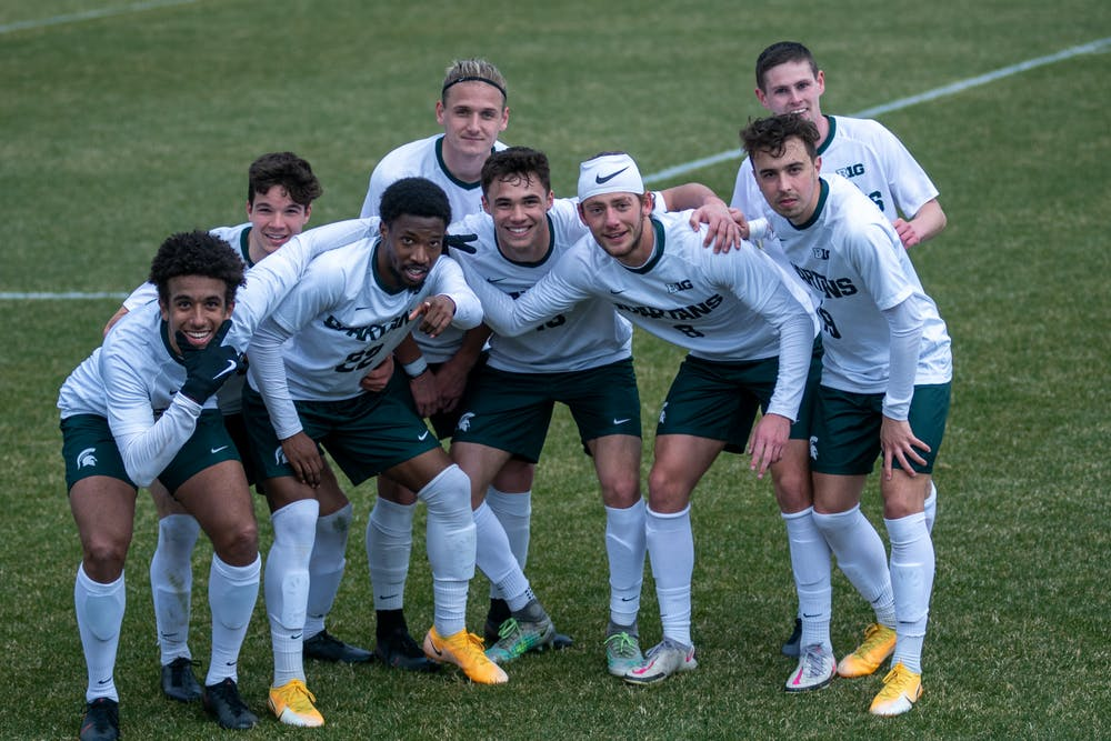 Members of the Michigan State men's soccer team after the 3rd goal of the game against Wisconsin at DeMartin Stadium in East Lansing.
