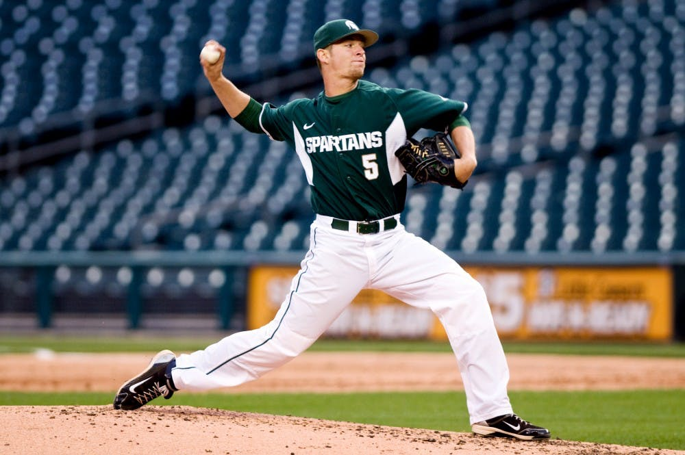 <p>Sophomore pitcher Andrew Waszak throws a pitch April 20 at Comerica Park in Detroit. Waszak allowed one run in seven innings to record his third win of the season in the Spartans' 3-1 victory over Central Michigan. </p>