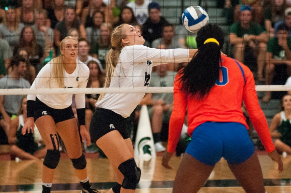 Junior setter Rachel Minarick (12) bumps the volleyball during the volleyball game against the University of Florida on Sept. 4, 2016 at Jenison Field House. The Spartans were defeated by the Gators, 3-0.