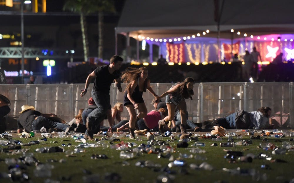 People run from the Route 91 Harvest country music festival after apparent gun fire was heard on October 1 in Las Vegas.  A shooter opened fire from within Mandalay Bay Resort and Casino. David Becker | Getty Images