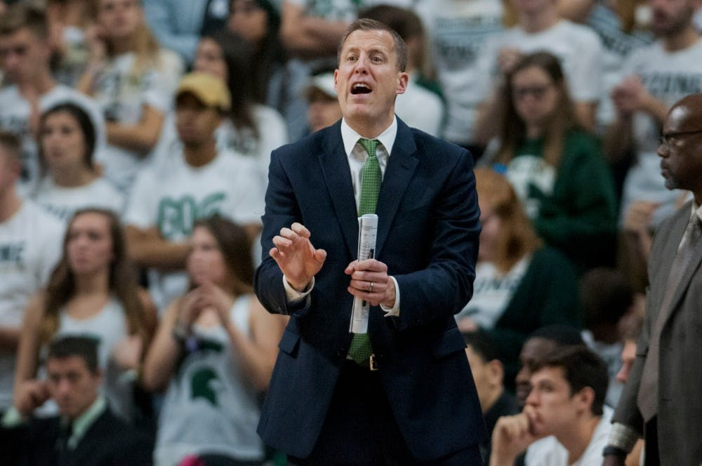 <p>Assistant coach Dane Fife yells at the team before a play during the second half of the game against Oral Roberts on Dec. 3, 2016 at Breslin Center. The Spartans defeated the Golden Eagles, 80-76. </p>