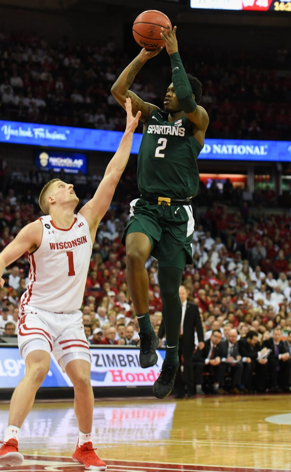 <p>Freshman guard Rocket Watts (2) shoots over a defender during the basketball game against Wisconsin on Feb. 1, 2020 at the Kohl Center in Madison, Wisconsin. The Spartans fell to the Badgers, 63-64.</p>