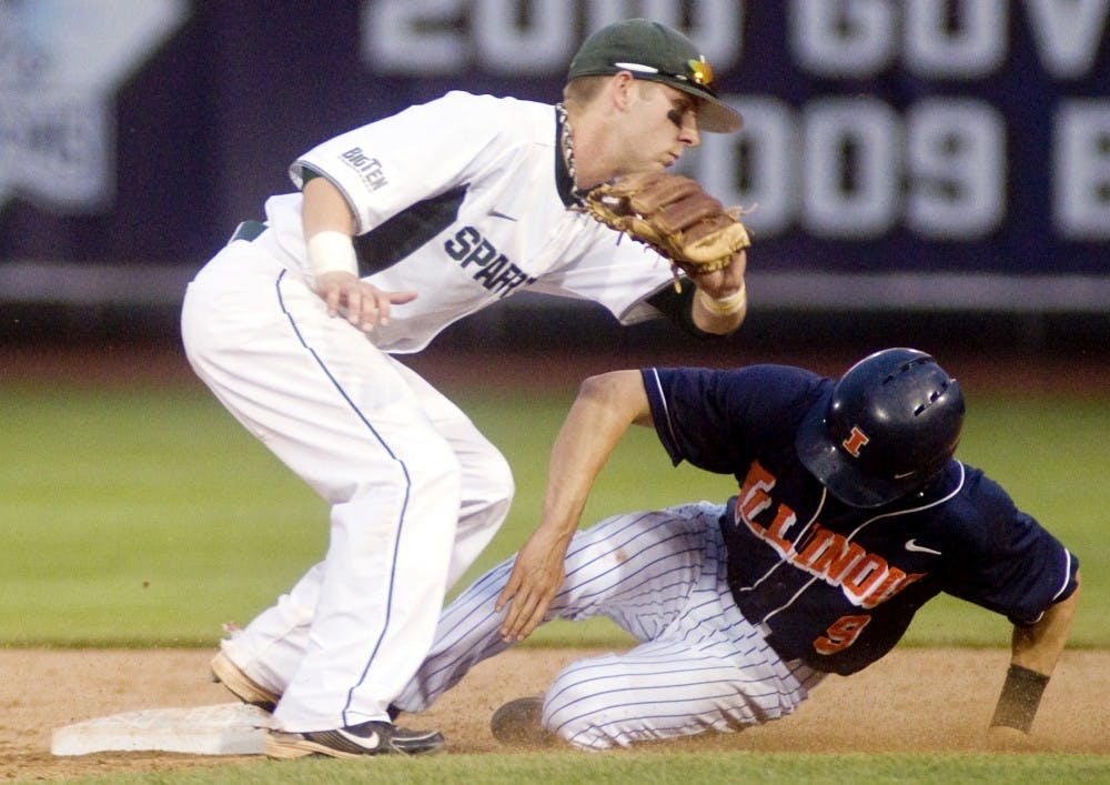 Sophomore infielder Ryan Jones attempts to tag out Illinois shortstop Josh Parr as he steals second base on May 28, 2011 at Huntington Park in Columbus, Ohio. The Spartans fell to the Fighting Illini, 9-1. Kat Petersen/The State News