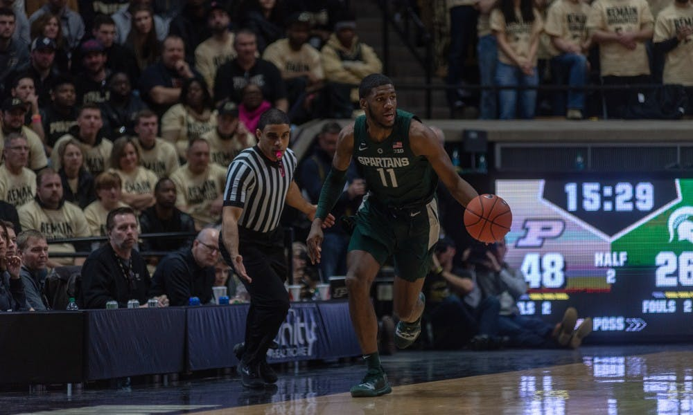Freshman forward Aaron Henry (11) begins a fast break following a steal at Mackey Arena on Jan. 27, 2019. The Spartans fell to the Boilermakers, 73-63.
