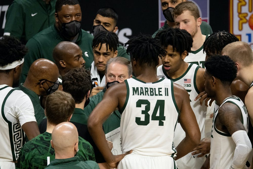 <p>MSU strategizes during halftime in a game against OSU on Feb. 25, 2021.</p>