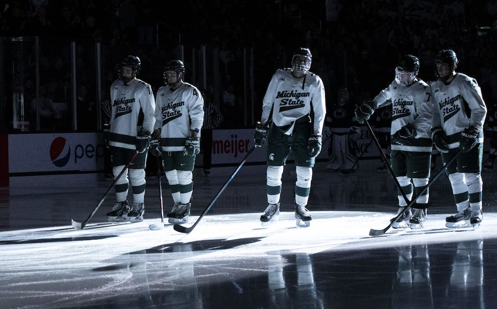 <p>Spartan starters line up on center ice before their game against the Nittany Lions. Michigan State fell to Penn State 2-1 on Jan. 25, 2020.</p>