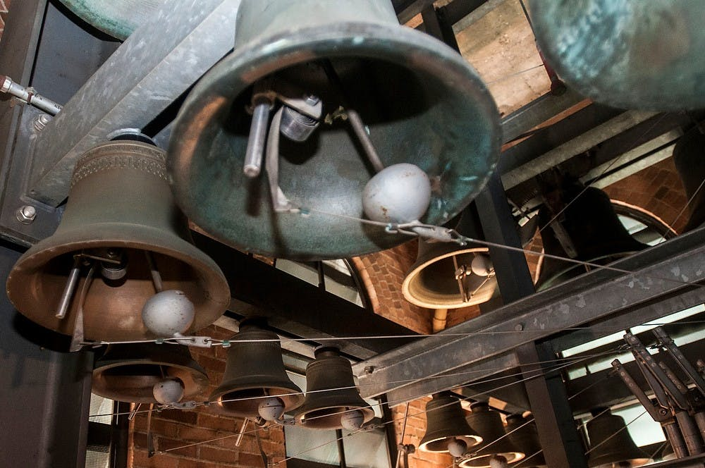 """<p>Some of the bells toll Oct. 8, 2013, at Beaumont Tower. <span class=""""caps"""">MSU</span>&#8217;s carillon has 49 bells, with the largest one weighing 2.5 tons. Margaux Forster/The State News</p>"""