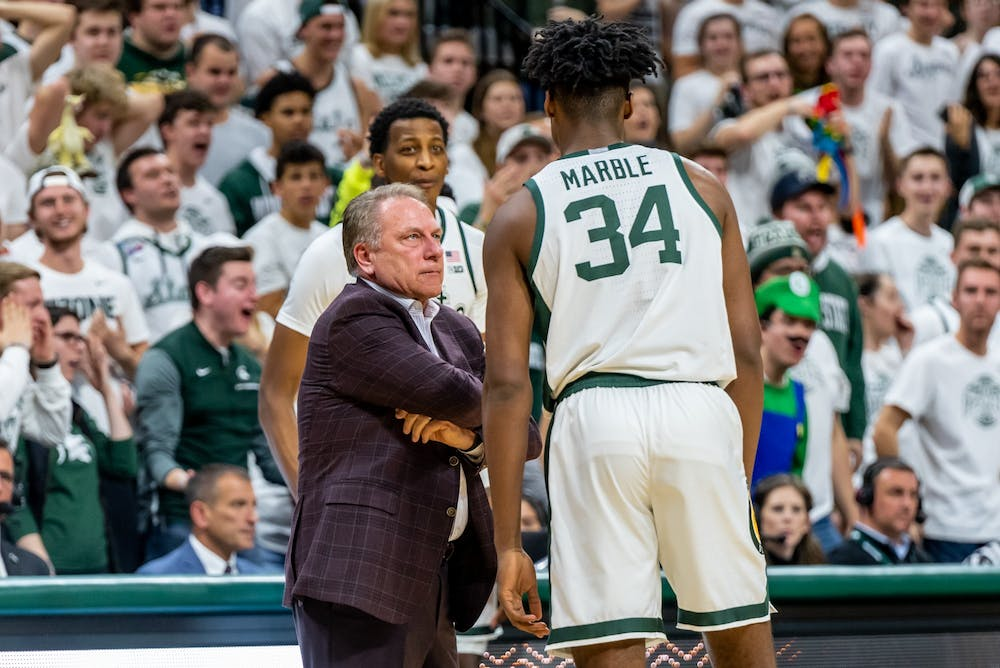 <p>Coach Tom Izzo (left) pouts towards freshman forward Julius Marble (34) after a foul was called on Marble for hanging on the rim. The Spartans defeated the Wildcats, 79-50, on Jan. 29, 2020 at the Breslin Student Events Center.</p>