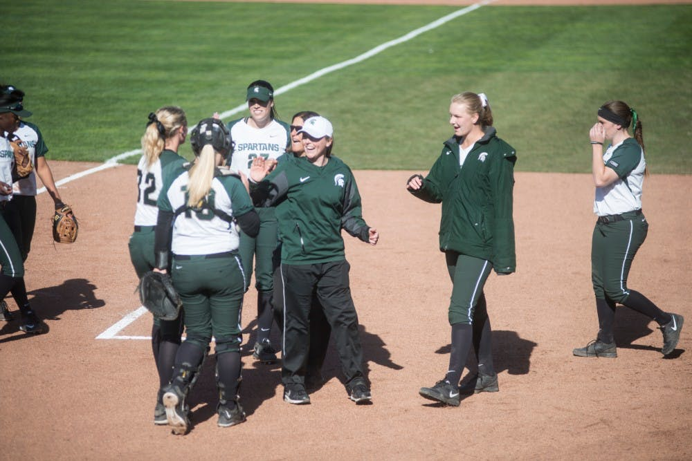 Assistant coach Kaela Jackson high fives players during the game against Broncos on March 29, 2016 at Secchia Softball Stadium. The Spartans defeated the Western Broncos, x-x.