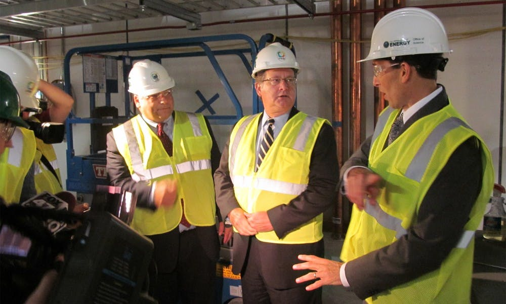 <p>From left to right, Mark Burnham, vice president of governmental affairs for MSU, Sen. Gary Peters (D.-Mich.) and Paul Mantica, deputy laboratory director and deputy project manager, tour FRIB on Sept. 21, 2015. Alex Kurrie/The State News</p>