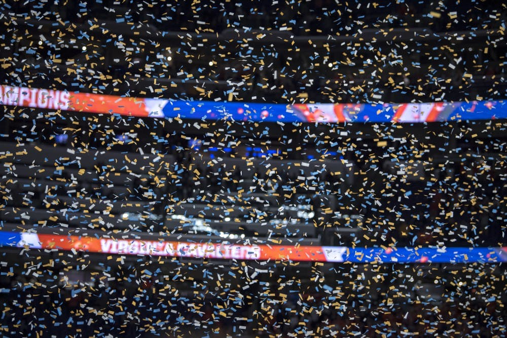 Confetti falls after Virginia defeated Texas Tech in the NCAA Tournament Championship game at U.S. Bank Stadium in Minneapolis on April 8, 2019. Virginia defeated Texas Tech in overtime 85-77. (Nic Antaya/The State News)
