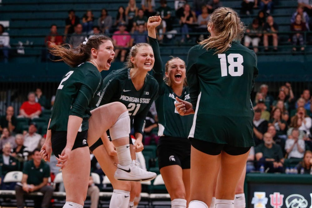 <p>The Spartans celebrate winning a match during the game against Cincinnati on Sept. 6, 2019, at Jenison Fieldhouse. The Spartans defeated the Bearcats, 3-1.</p>