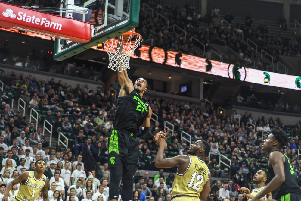 <p>Junior forward Xavier Tillman (23) dunks the ball during the game against the Charleston Southern Buccaneers on Nov. 18, 2019 at Breslin Center. The Spartans defeated the Buccaneers, 94-46.</p>