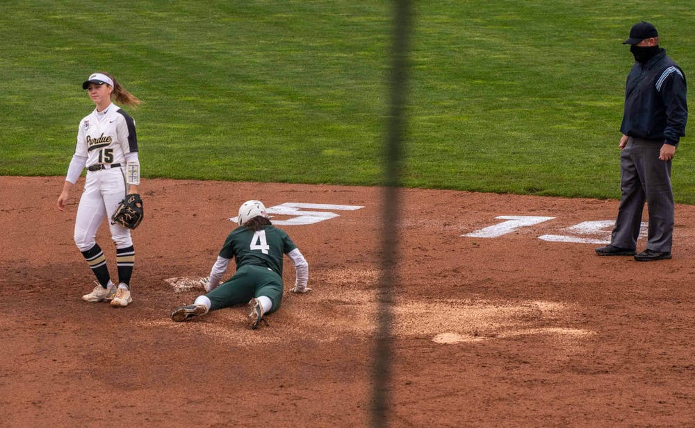 <p>Senior outfielder Katie Quinlan (4) steals a base in the fourth inning without Purdue&#x27;s infielder Rachel Becker noticing. The Boilermakers made a seven-run comeback in the sixth inning to top the Spartans 9-6 at Secchia Stadium on April 24, 2021.</p>