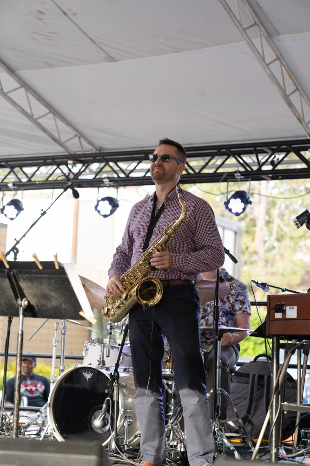 <p>A saxophone musician is performing at the 23rd East Lansing Summer Solstice Jazz Festival on June 21.</p>