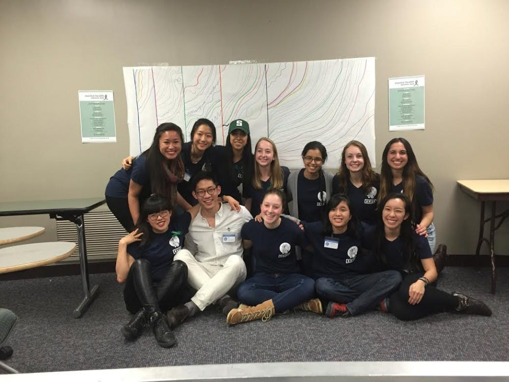 """<p>Members of Olin Health Center's Student Health Advisory Council pose for a picture during the """"Embrace The Rain"""" event March 23, 2016. The event was put on as part of&nbsp;Mental Health Awareness Week.&nbsp;</p>"""