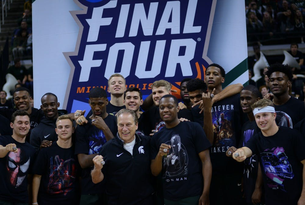 MSU men's basketball team poses in front of the 2018-2019 season Final Four banner that was hung during Michigan State Madness at the Breslin Center on October 25, 2019.