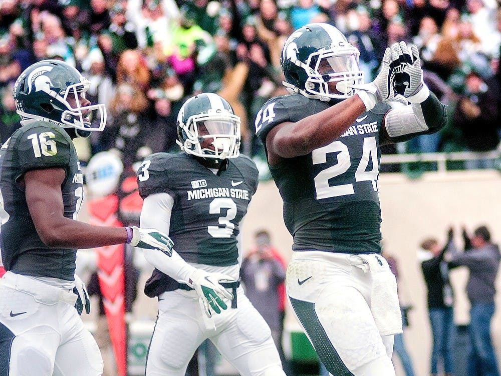 <p>Junior running back Le&#8217;Veon Bell celebrates by showing the Spartan logo with his gloves after scoring a touchdown Nov. 3, 2012, at Spartan Stadium. Bell rushed for 188 yards and scored two touchdowns during the 28-24 loss to Nebraska. State News File Photo</p>
