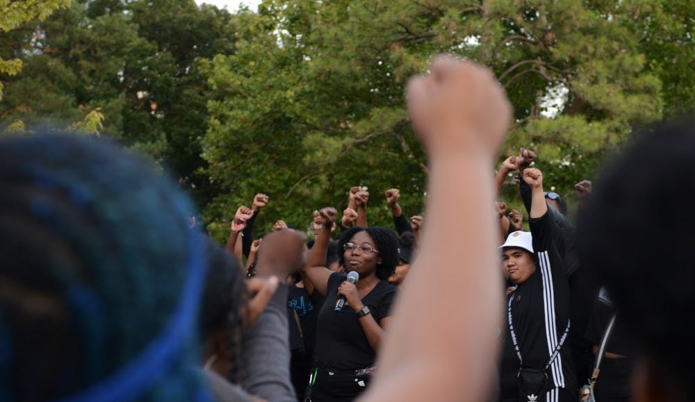 <p>Black Student Alliance MSU president Sharron Reed-Davis gave a speech protesting the newly implemented block tuition at MSU during Spartan Remix behind Wells Hall on Sept. 5, 2019. Many students wore black to the event in support of the protest. </p>