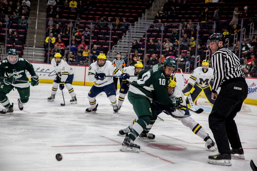 Junior center Sam Saliba (10) watches the puck during the game against Michigan on Dec. 31, 2018 at Little Caesar's Arena in Detroit. The Spartans were ahead 2-1 at the end of the 1st period.