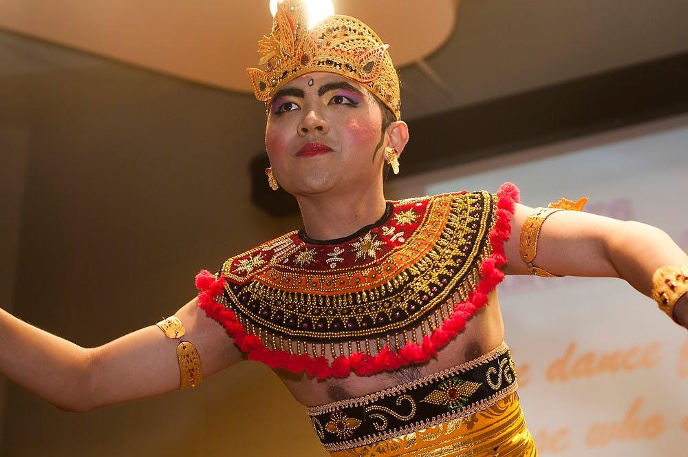 """<p>Indiana University graduate student Awan Purnawan does a traditional bali dance Nov. 16, 2013, in the Erickson Hall Kiva. The <span class=""""caps"""">MSU</span> Indonesian Student Association put on the sixth annual Indonesian Culture Night which shows traditional dancing, music and authentic foods.</p>"""