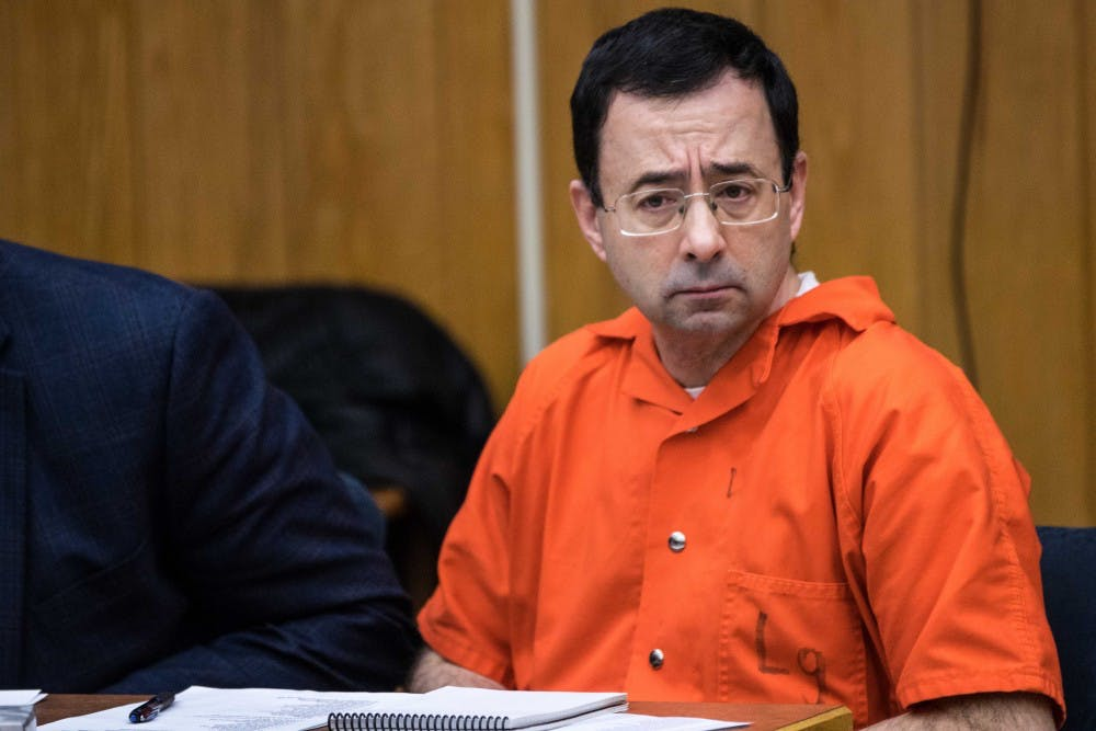 Larry Nassar listens to a victim impact statement during the first day of his sentencing on Jan. 31, 2018, in the Eaton County courtroom. Nassar faces three counts of criminal sexual conduct in Eaton County.