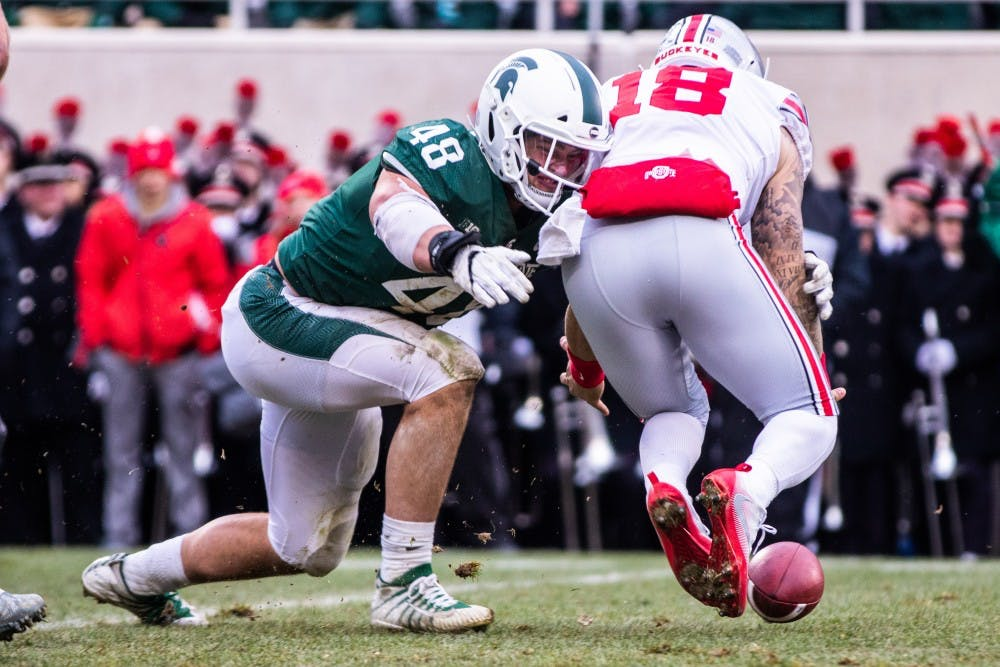 Junior defensive end Kenny Willekes (48) hits Ohio State quarterback Tate Martell (18) as the ball falls loose during the game Nov. 10, 2018. The Spartans fell to the Buckeyes, 26-6.