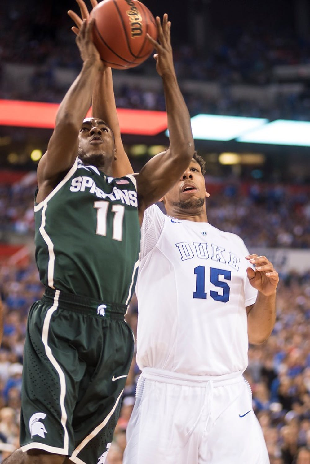 """<p>Freshman guard Lourawls """"Tum Tum"""" Nairn attempts a basket April 4, 2015, during the semi-final game of the NCAA Tournament in the Final Four round at Lucas Oil Stadium in Indianapolis, Indiana. The Spartans were defeated by the Blue Devils, 81-61. Erin Hampton/The State News</p>"""
