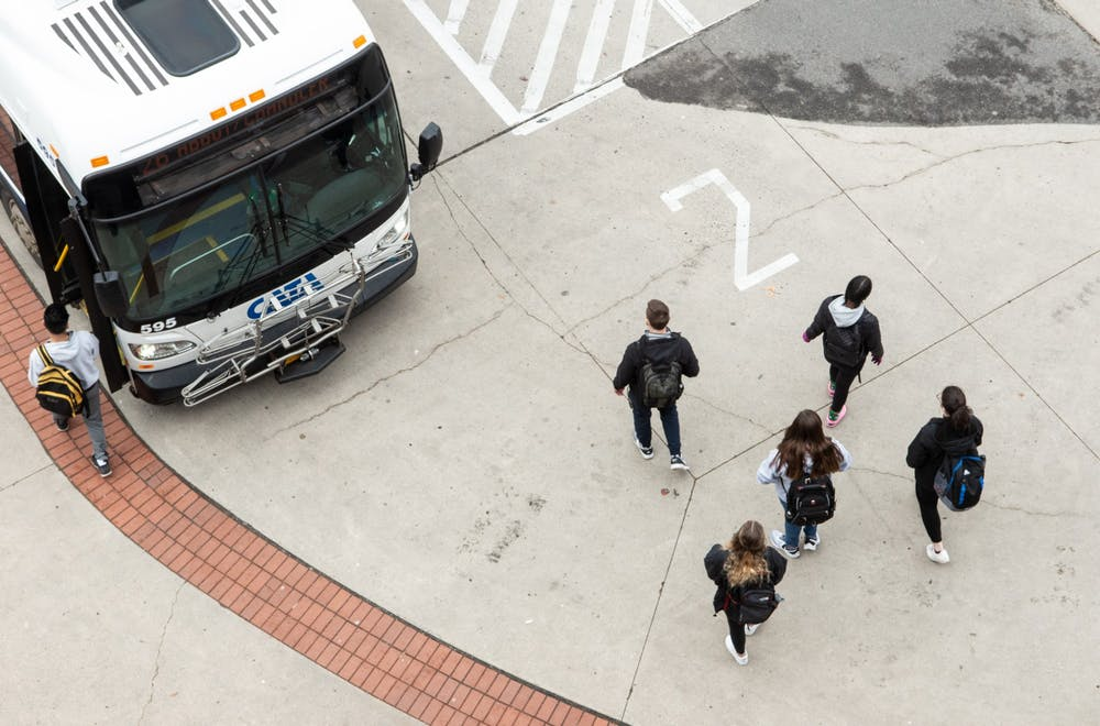 <p>Students board a CATA bus after an email was released notifying students that MSU canceled classes after noon March 11, 2020.</p>