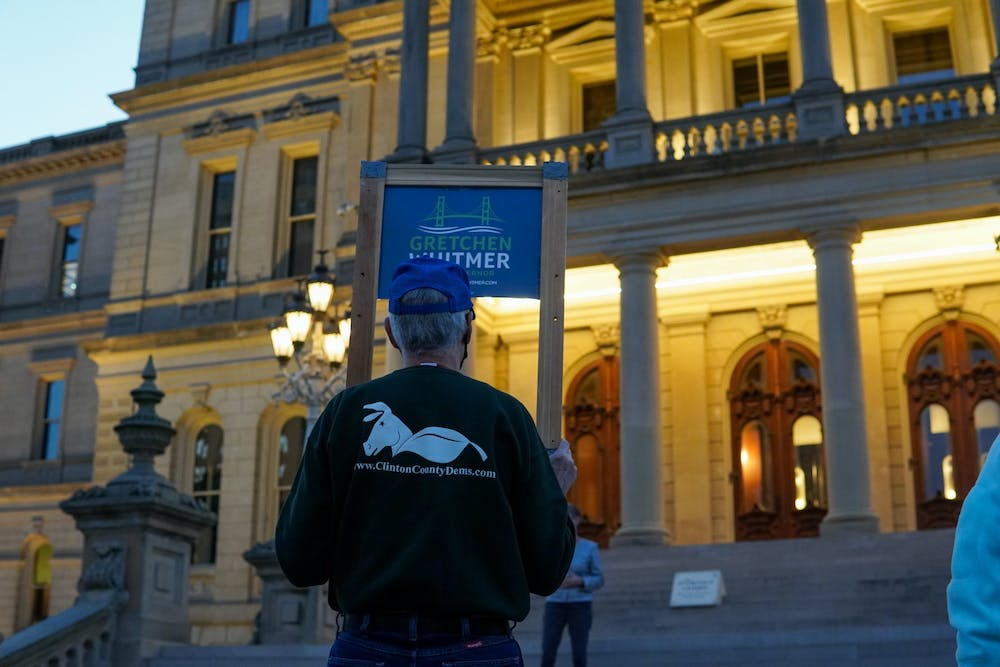 A Gretchen Whitmer supporter standing outside the Capitol on Oct. 8, 2020.