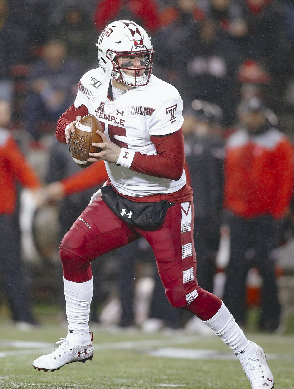 <p>Temple quarterback Anthony Russo drops back for a pass against Cincinnati in 2019. Russo announced on Dec. 16 that he would be transferring to Michigan State after playing in 31 games for the Owls. Photo courtesy of Zamani Feelings/Temple Athletics.</p>