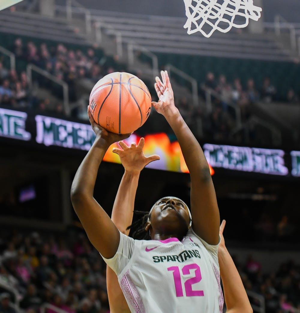 Senior forward Nia Hollie (12) goes up for a basket during the women's basketball game against Michigan at the Breslin Center on February 23, 2020. The Spartans fell to the Wolverines 65-57.