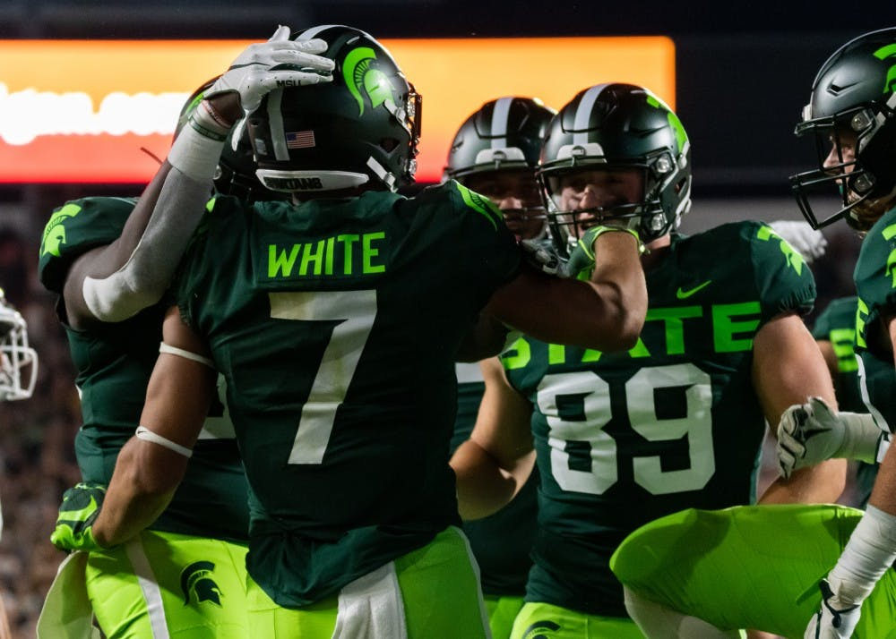 <p>Junior wide receiver Cody White (7) celebrates with his teammates after a touchdown against Western Michigan. The Spartans defeated the Broncos, 51-17, on Sept. 7, 2019 at Spartan Stadium.</p>