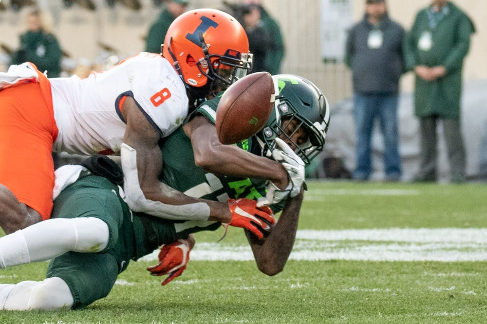 Freshman wide receiver Tre Mosley (17) tries to bring in a pass during the game against Illinois Nov. 9, 2019 at Spartan Stadium.