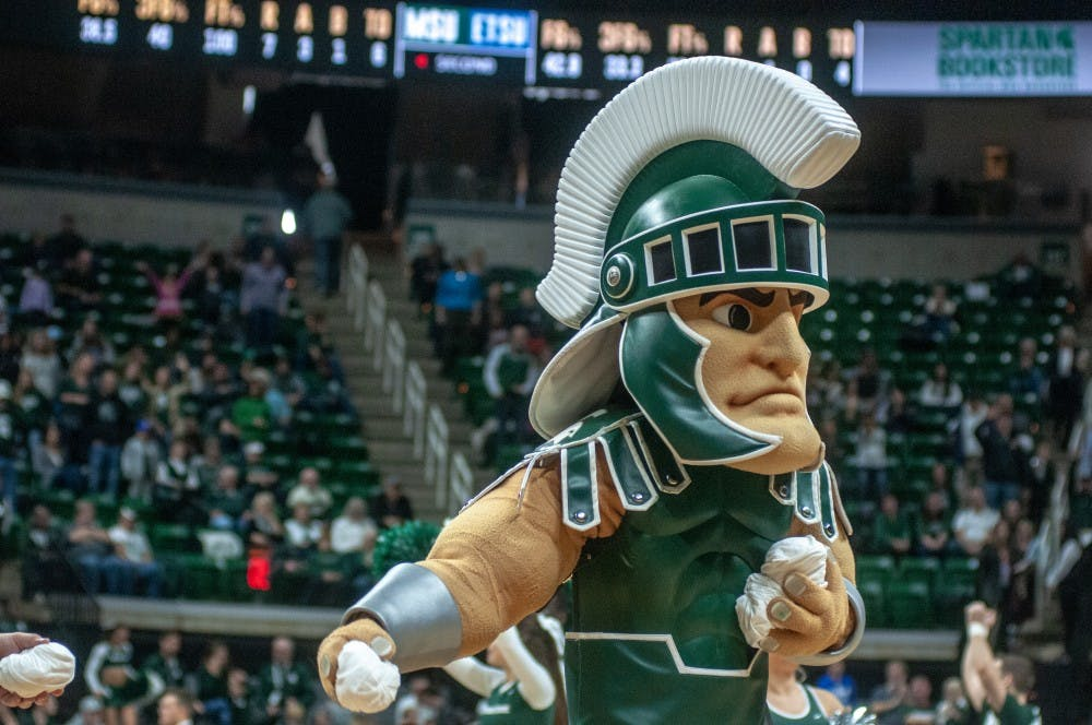 <p>Sparty throws T-shirts into the crowd during the game against East Tennessee State Nov. 11, 2018 at Breslin Center. The Spartans lead the Buccaneers at halftime, 32-29.</p>