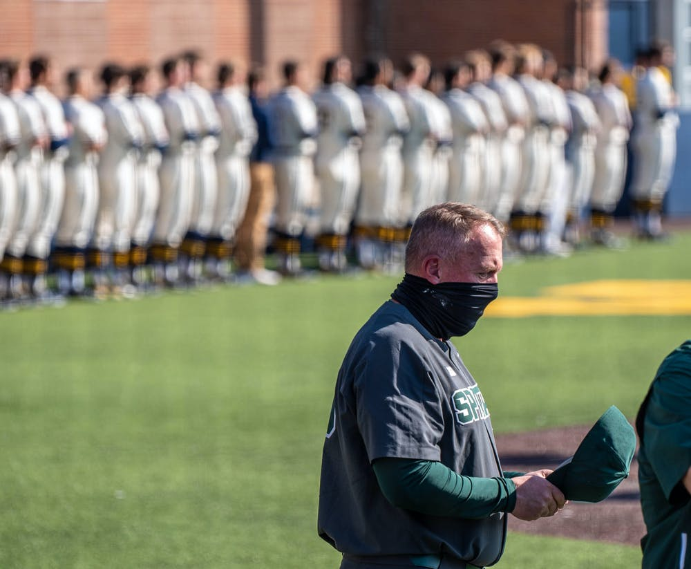 <p>Coach Jake Boss Jr. puts his hat back on after the national anthem. The Wolverines made a comeback in the ninth inning to top the Spartans 8-7 at Ray Fisher Stadium on March 21, 2021.</p>