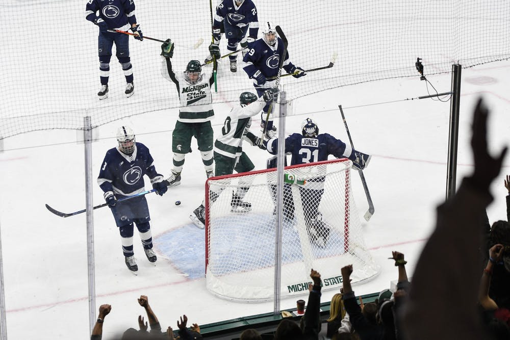 <p>Spartan athletes and fans celebrate a goal during a hockey game against Penn State on Jan. 24, 2020, at Munn Ice Arena. The Spartans defeat the Nittany Lions, 4-2.</p>