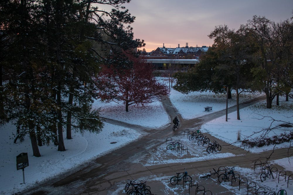 The sun rises over the sidewalk intersection between the International Center and Wells Hall on Nov. 13, 2019.