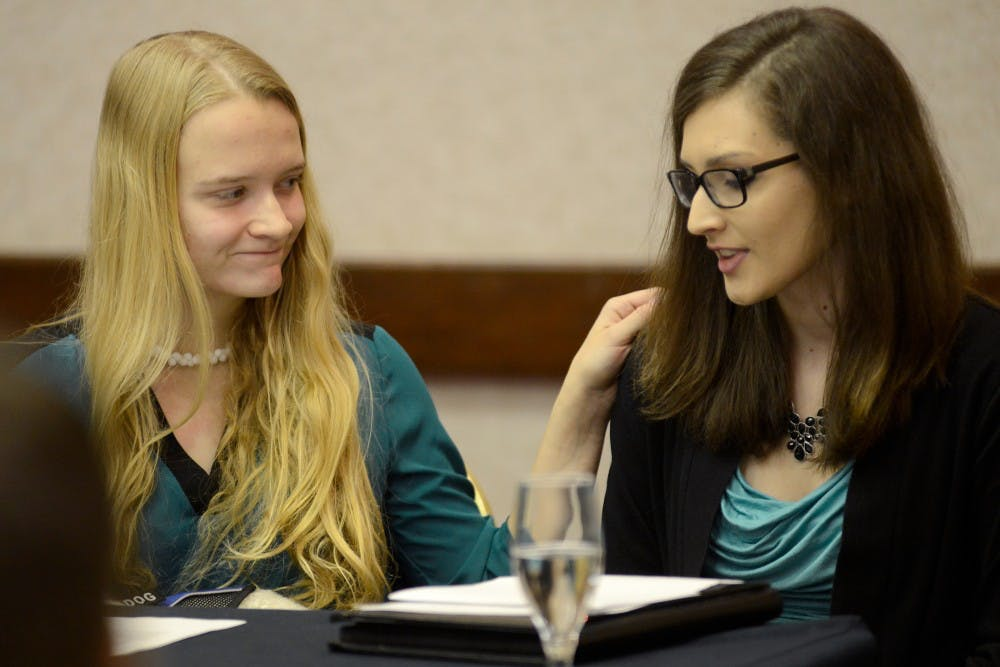 <p>Emily Kollaritsch, left, comforts Shayna Gross after Gross made a statement regarding her alleged assault during a press conference on Nov. 18, 2015 at the Marriott in East Lansing. Kollaritsch and Gross were students at MSU when they were allegedly assaulted. Four individuals, including Kollaritsch and Gross,&nbsp;filed a Title IX campus sexual assault civil lawsuit against the Michigan State University, which alleges that MSU failed to adequately investigate complaints of sexual assault. </p>