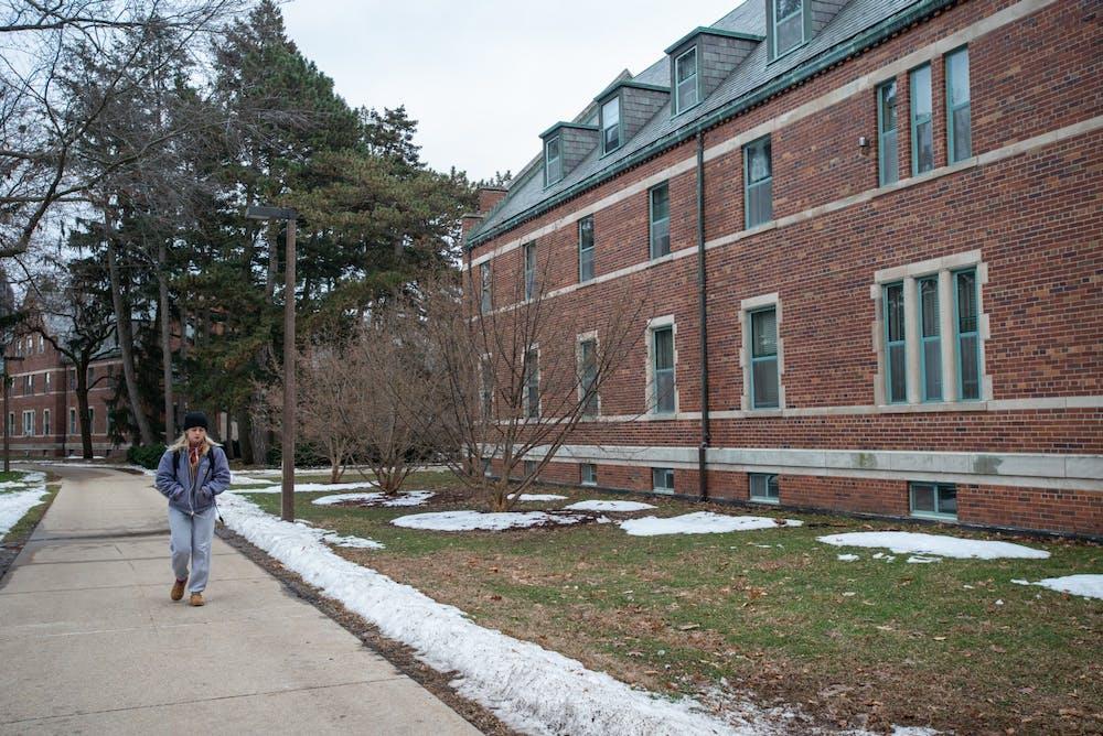 <p>A student walks past Mason Hall on Jan. 27, 2020.</p>